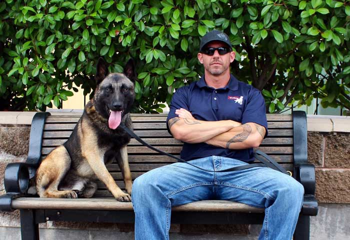 About Mike Ritland on bench with dog