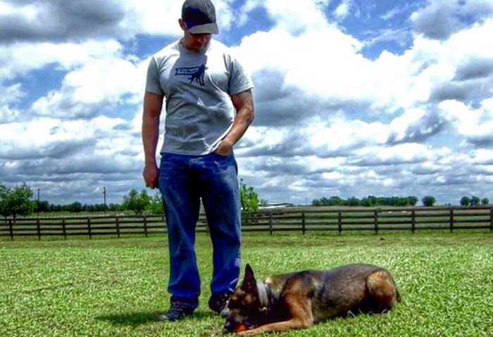 mike ritland in field with dog