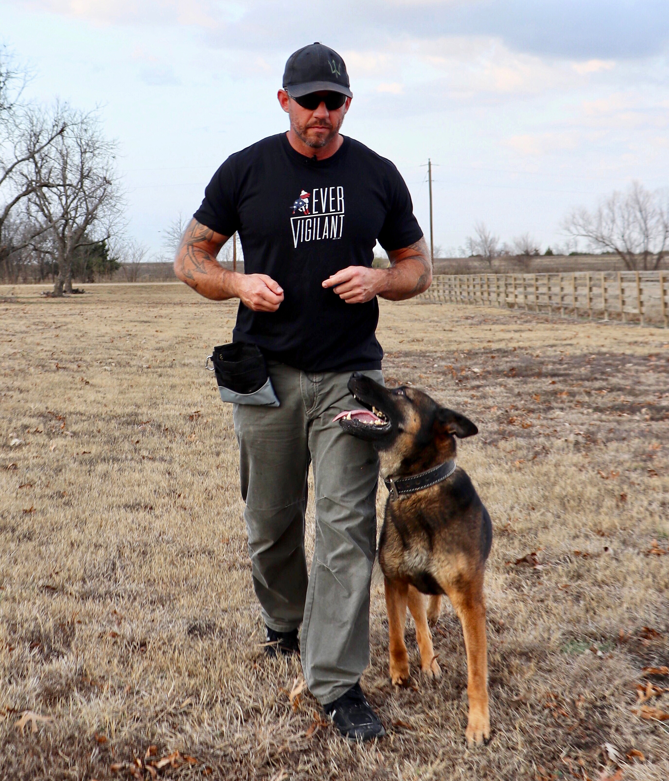 mike ritland running with dog in field